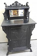 Small ebonized mirror back eastlake cabinet
