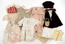 Grouping of antique and vintage doll clothes
