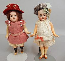 Two bisque socket head dolls