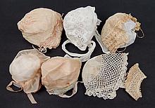 Seven doll bonnets