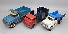 Three pressed steel trucks