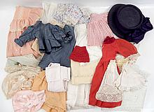 Large grouping of assorted doll clothes
