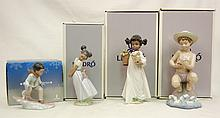 Grouping of four boxed Lladro figurines