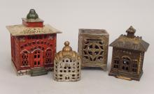 Four small cast iron banks