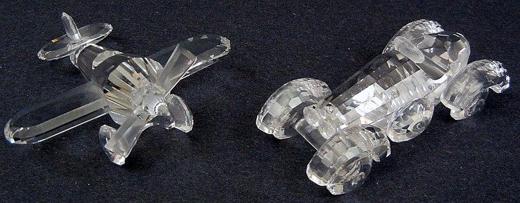Two Swarovski crystals, including an airplane, 3