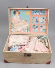 Grouping of doll clothes in Dy-Dee doll trunk