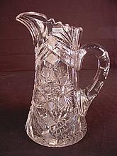 Cut glass pitcher, 10in. T, 7in. W.