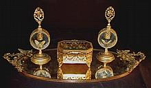 Four piece bronze dore dresser set with mirror tray, two perfume bottles and jewelry box with butterfly tray, 22in. L, 10in. W.