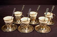 Set of 6 demitasse cups and saucers, marked SSMC sterling and Lenox China, ca. 1925.