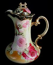 Hand painted Nippon pitcher with roses, 9in. T, 7in. from spout to handle.
