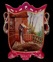 Old paris porcelain vase with double handle, reticulated mouth, classical lady with cat overlooking courtyard, 14in. T, 12in. W, 6.25in. D.
