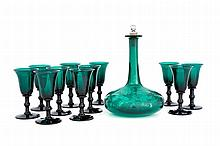 A Victorian green glass and engraved decanter