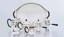 An assembled Danish four-piece sterling silver tea and coffee service, Georg Jensen, 1927-1932, No. 28