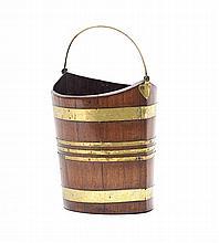 A George III mahogany brass-bound bucket