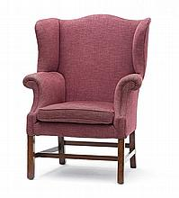 A George III mahogany and upholstered wingback armchair