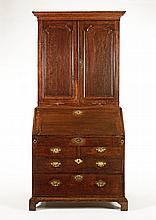 A George III oak bureau bookcase with moulded