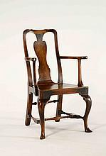 A George I style fruitwood and pine armchair with