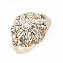 SILVER AND GOLD  ART NOUVEAU RING WITH DIAMONDS. CIRCA 1900.