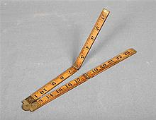 WARRANTED BOSWOOD RABONE. Hardwood English carpenter's metre rule, with fou