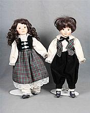 A pair of dolls from the 1970's. Arms, legs and head in polychromed porcela