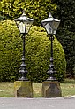 A pair of Victorian cast iron pier lanterns, circa