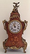 A 19TH CENTURY FRENCH WALNUT AND FLORAL MARQUETRY