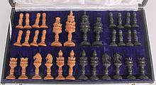 AN INDIAN SANDALWOOD AND EBONY CHESS SET, CIRCA 1920