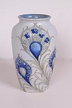 A MOORCROFT BLUE AND WHITE VASE