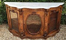 A GOOD VICTORIAN FIGURED WALNUT SERPENTINE MARBLE TOPPED CREDENZA With three glazed doors, raised on plinth base. (h 89cm x w 154cm x d 43cm)