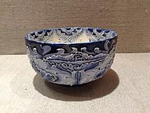 MOORCROFT MACINTYRE, AN EDWARDIAN POTTERY BOWL Decorated with a blue and white Florian pattern, with stylized painted flowers, tube lined. (approx d 10.3cm x h 5.5cm)