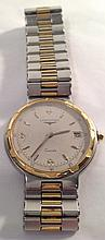 LONGINES, CONQUEST, A STAINLESS STEEL AND GOLD MID SIZE WRISTWATCH Having a circular grey tone dial, gilt numerals, calendar window and gilt bezel, on a steel and gold bracelet. (approx d 3cm) 5399/10926/1