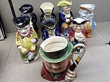 A COLLECTION OF SEVEN 19TH CENTURY AND LATER TRADITIONAL TOBY JUGS