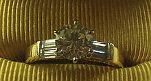 A ROUND BRILLIANT CUT DIAMOND SOLITAIRE RING (COLOUR J-K CLARITY VVS)