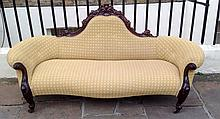 AN EARLY VICTORIAN SCROLL END THREE SEATER SETTEE