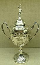 A LARGE 19TH CENTURY SOLID SILVER SPORTING TROPHY