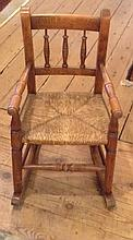 AN EARLY 20TH CENTURY CHILD'S BEECH WOOD ELBOW CHAIR