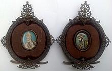 A PAIR OF 19TH CENTURY OVAL MINIATURE PORTRAITS ON IVORY