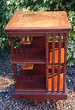 A MATCHED PAIR OF EDWARDIAN MAHOGANY REVOLVING BOOKCASES.