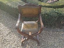 AN EARLY 20TH CENTURY MAHOGANY AND GREEN LEATHER UPHOLSTERED THRONE ARMCHAIR