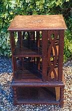 AN EARLY 20TH CENTURY OAK REVOLVING BOOKCASE
