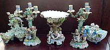 A COLLECTION FIVE 19TH CENTURY CONTINENTAL FIGURAL CENTREPIECES