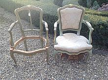 A PAIR OF 19TH CENTURY FRENCH PAINTED AND GILT ARMCHAIR FRAMES.