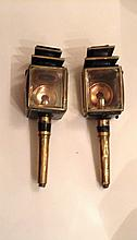 A PAIR OF VICTORIAN BRASS AND PAINTED COACHING LAMPS