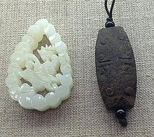 A CHINESE PALE GREEN JADE PENDANT
