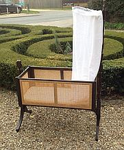 A LATE VICTORIAN MAHOGANY AND CANE CHILD'S CRADLE