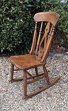 A VICTORIAN ASH AND ELM ROCKING CHAIR