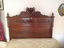 A LATE 19TH CENTURY FRENCH OAK DOUBLE BEDSTEAD