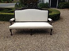 A 19TH CENTURY OAK AND CALICO UPHOLSTERED SETTEE