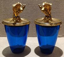 A PAIR OF BLUE GLASS JARS WITH SHORT-TAILED EAGLE ORMOLU MOUNTED COVERS