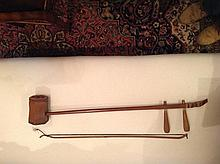 A NORTH AFRICAN HARDWOOD MUSICAL INSTRUMENT With fretwork panel, sound